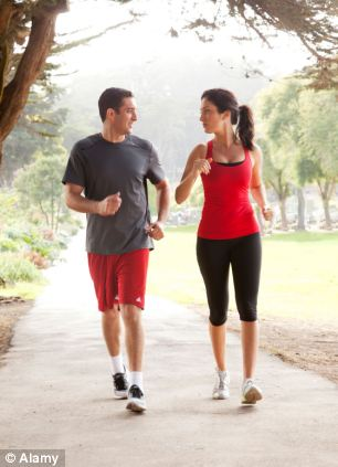 A long walk can significantly improves insulin sensitivity and blood lipid levels (stock photo)