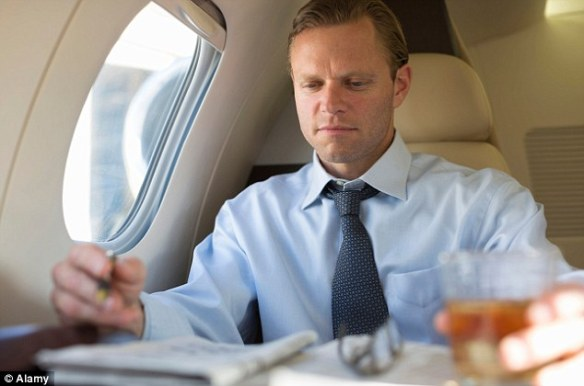 Not at our best: Britain's top aviation doctor says it is best to relax rather than trying to work while flying