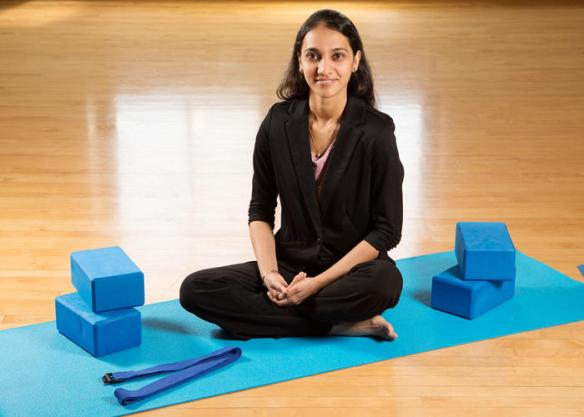University of Illinois graduate student Neha Gothe and her colleagues found that 20 minutes of yoga significantly improved participants' reaction time and accuracy in tests of cognitive function. Gothe is now a professor of kinesiology at Wayne State University in Detroit. (Credit: Image courtesy of University of Illinois at Urbana-Champaign)