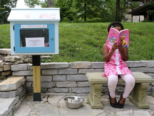Reading now may protect your memory later in life, a new study suggests. (Photo: Leigh Taylor, The Cincinnati Enquirer, via AP)